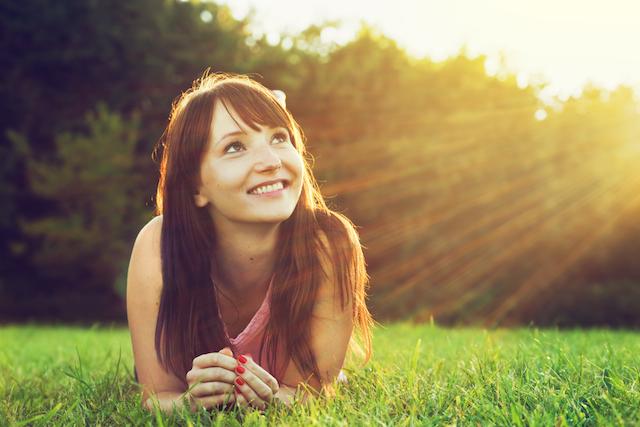 Happy-Woman-on-Grass